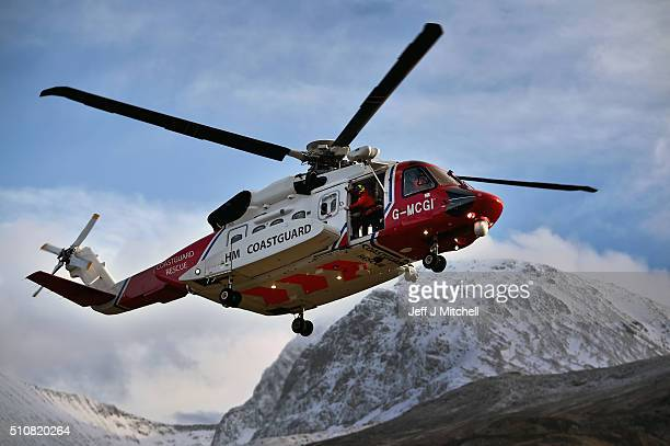 Rescuers resume a search with help from a Coastguard helicopter for two experienced climbers missing on Ben Nevis on February 17 2016 in Fort William...