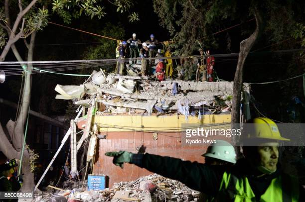 Rescuers search for people missing beneath a collapsed building in Mexico City on Sept 20 a day after an earthquake with a magnitude of 71 shook...