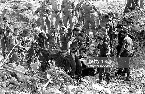 Rescuers search for survivors 25 October 1983 in Beirut through the rubble of the -Drakkar- building which was destroyed by a suicide truck bomber...