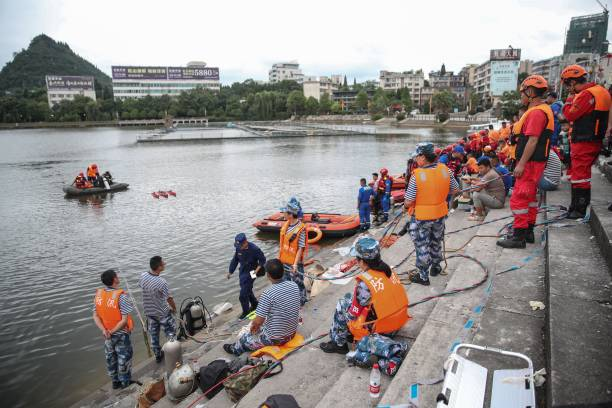 CHN: Bus Falls Into Reservoir In SW China