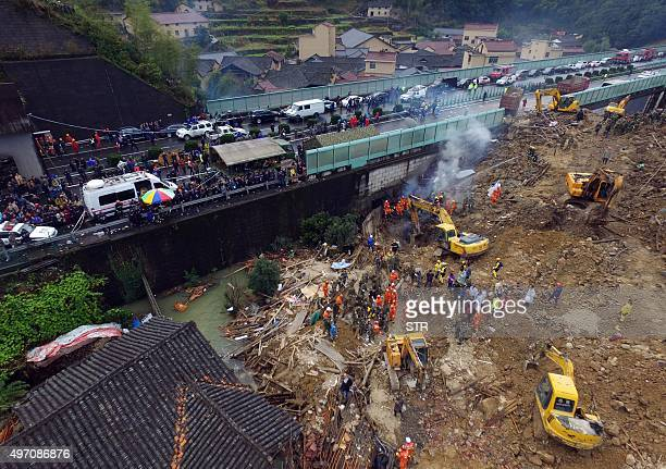 Rescuers search for survivors after a landslide in Lishui east China's Zhejiang province on November 14 2015 Seven people were confirmed dead and 30...