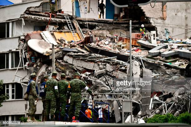 TOPSHOT Rescuers search for survivors amid the rubble from a building flattened by the 71magnitude quake the day before in Mexico City on September...