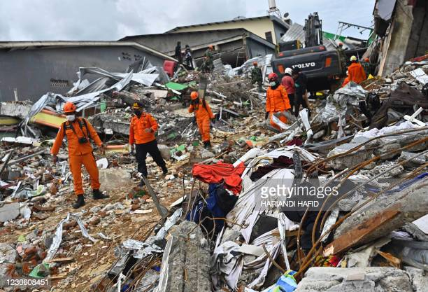 Rescuers search for survivors at a collapsed building in Mamuju city on January 16 a day after a 6.2-magnitude earthquake rocked Indonesia's Sulawesi...