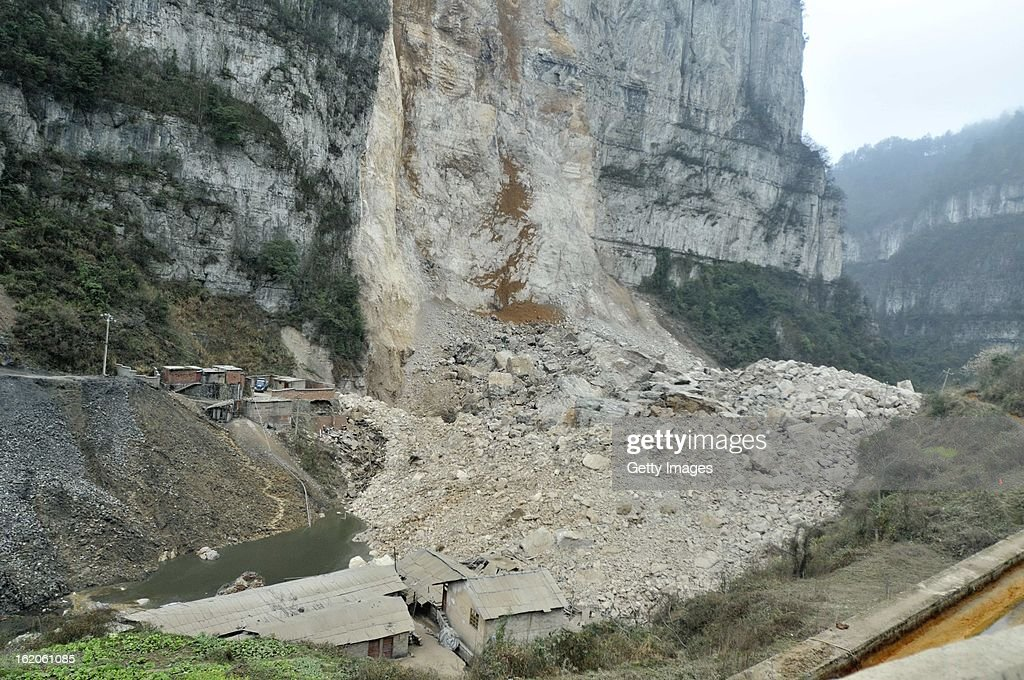 Rescuers search for survivors at the scene of a landslide at Yudong Village on February 18, 2013 in Kaili, Guizhou Province of China. At least five people including two children were buried after a landslide hit Yudong Village of Longchang Township in Kaili, southwest China's Guizhou Province on Monday morning.