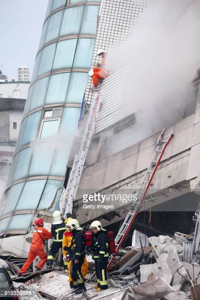 Rescuers search for survivors from a damaged building on February 7, 2018 in Hualien County, Taiwan. Aftershocks continue to rattle Taiwan after a...