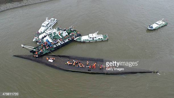 Rescuers search for survivors from the capsized ship Dongfangzhixing in the Yangtze River on June 2 2015 in Nanjing China A passenger ship named...