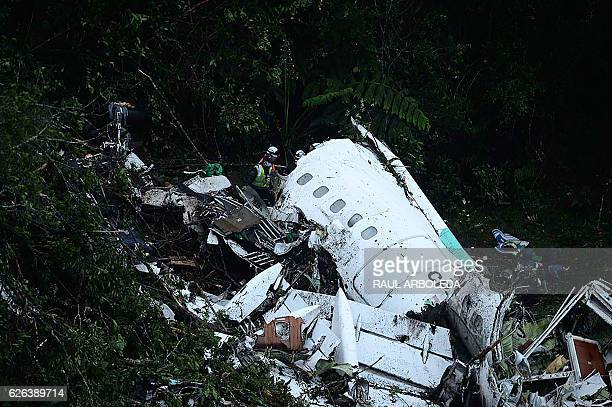 Rescuers search for survivors from the wreckage of the LAMIA airlines charter plane carrying members of the Chapecoense Real football team that...