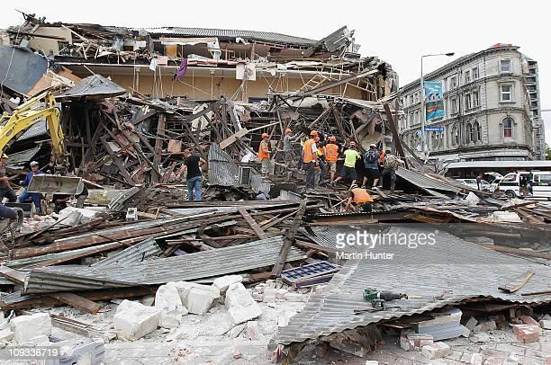 Rescuers search for survivors in a collapsed building in Manchester Street on February 22 2011 in Christchurch New Zealand The 63 magnitude...