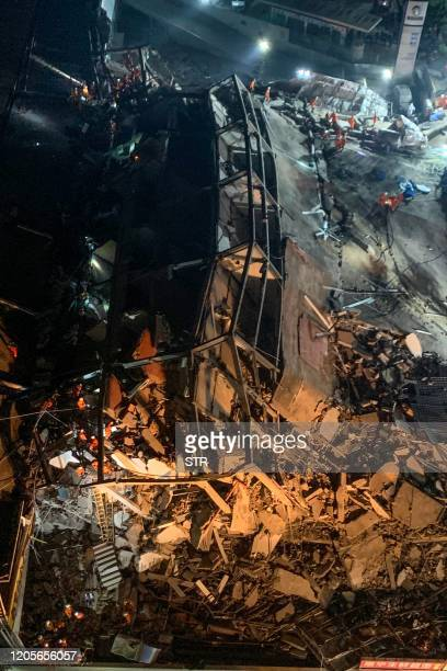 Rescuers search for survivors in the rubble of a collapsed hotel in Quanzhou, in China's eastern Fujian province on March 7, 2020. - Around 70 people...