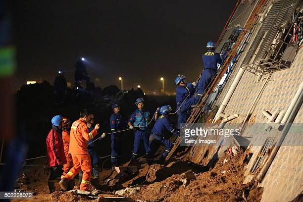 Rescuers search for survivors in the rubble of collapsed buildings on December 21 2015 in Shenzhen China The number of missing people was revised to...