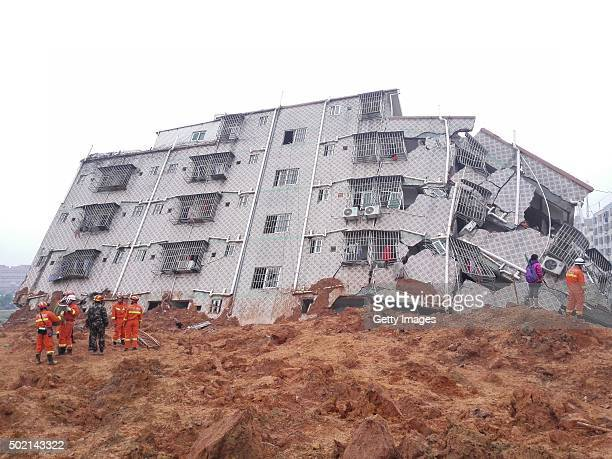Rescuers search for survivors on the rubble of collapsed buildings on December 21 2015 in Shenzhen China Three people were injured and at least 91...