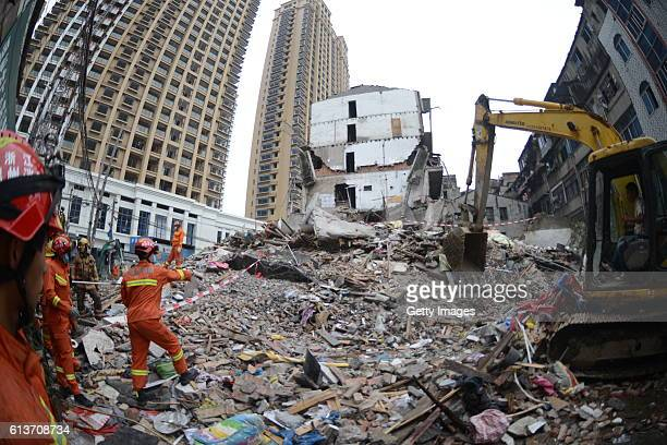 Rescuers search for survivors on the rubble of collapsed buildings on October 10 2016 in Wenzhou China At least four people were killed after four...