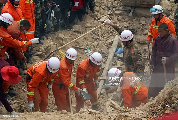 Rescuers search for the survivors on the debris of collapsed buildings in the earthquake-hit Gyegu town of Yushu County, Qinghai province April 20,...