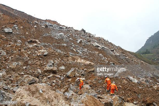Rescuers search for victims at the landslide accident site on March 23 2011 in Guangyuan Sichuan Province of China Six people were buried in a quarry...