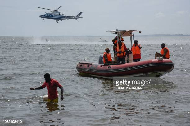 Rescuers search for victims at the site of a capsized cruise boat on Lake Victoria near Mutima village south of Kampala Uganda on November 25 2018...