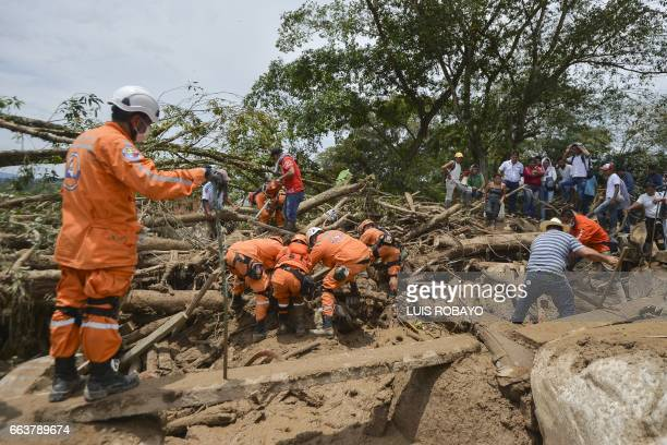 TOPSHOT Rescuers search for victims following mudslides caused by heavy rains in Mocoa Putumayo department southern Colombia on April 2 2017 The...