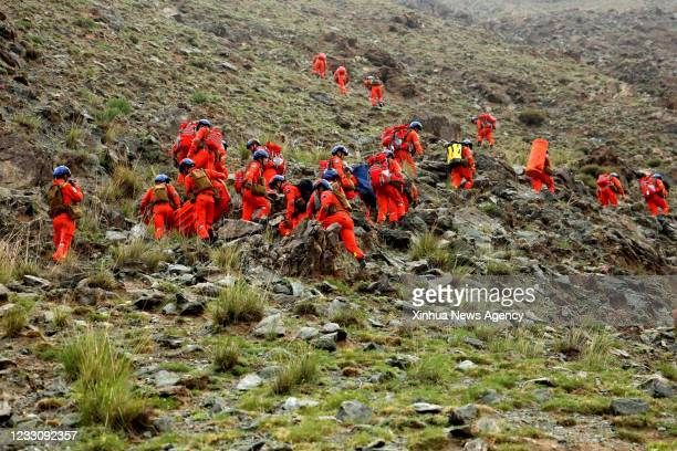 Rescuers search for victims in Jingtai County of Baiyin City, northwest China's Gansu Province, May 23, 2021. Lasting almost 24 hours, rescue work...