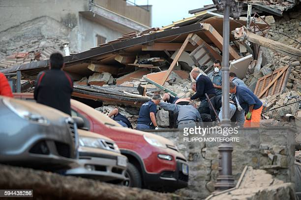 Rescuers search for victims in the rubble after a strong earthquake hit Amatrice on August 24, 2016. Central Italy was struck by a powerful,...