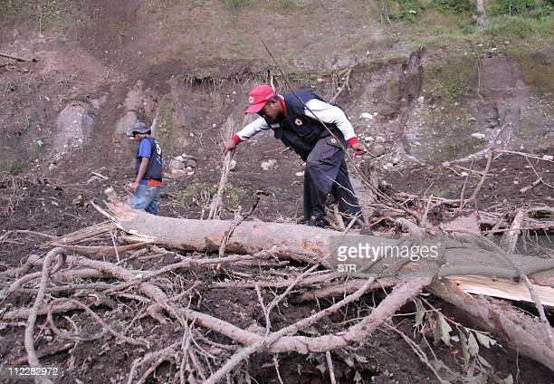 Rescuers search for victims under debris following a landslide that killed nine people and another seven injured in Klangon village in Indonesia's...