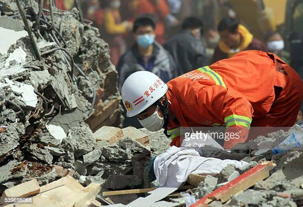 Rescuers search survivors from debris of destroyed house with her mother in the earthquake-hit town of Gyegu in Yushu County, Qinghai province April...