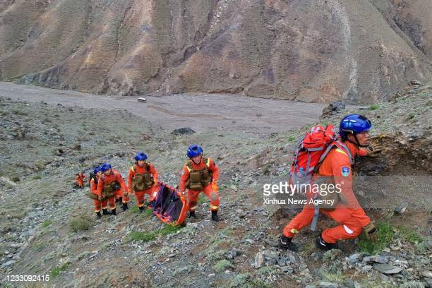 Rescuers set off to transfer the remains of victims in Jingtai County of Baiyin City, northwest China's Gansu Province, May 23, 2021. Lasting almost...