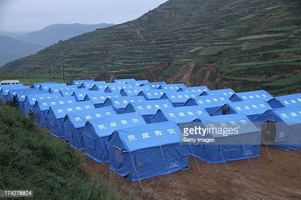 Rescuers set up tents at Majia village on July 23 2013 in Minxian China At least 89 people were killed and 5 others missing after a 66magnitude...