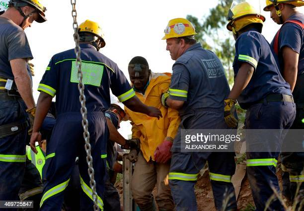 Rescuers tend to one of the 11 workers that were rescued from an illegal gold mine in Benoni outside Johannesburg on February 16 2014 Eleven workers...
