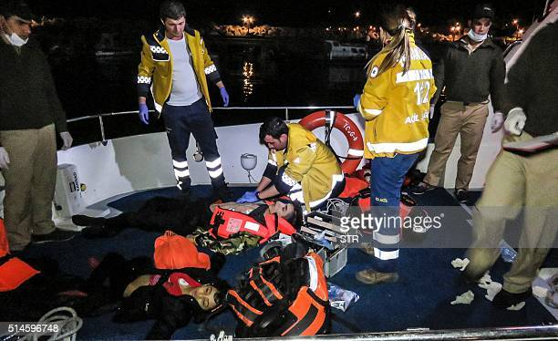 TOPSHOT Rescuers try to revive a person after a boat carrying refugees sank off on its way to Lesbos Island at Ayvacik district Canakkale on March 10...