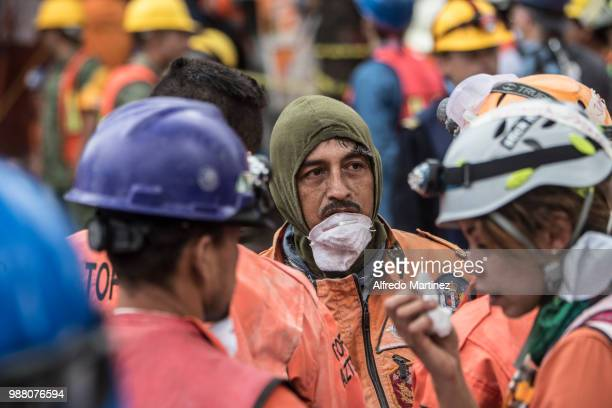 Rescuers volunteers and firefighters work after the magnitude 71 earthquake that jolted central Mexico damaging buildings knocking out power and...