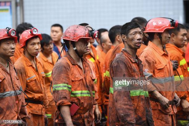 Rescuers wait outside the Songzao Coal Mine near Chongqing, in southwest China on September 27, 2020. - Sixteen workers died and one is in a critical...