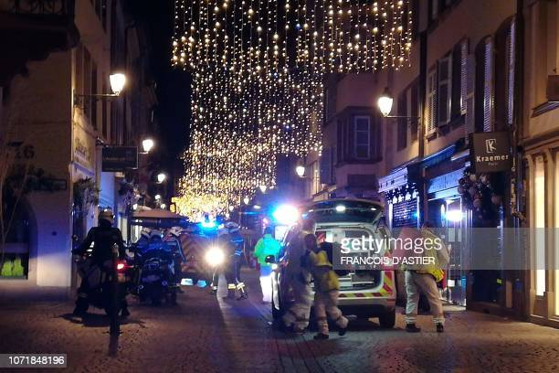 TOPSHOT Rescuers walk in the streets of Strasbourg eastern France after a shooting breakout on December 11 2018 At least two people have been killed...