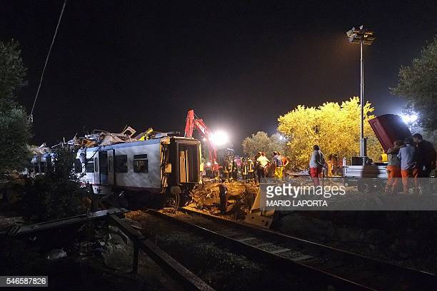 Rescuers work after a headon collision between two trains near Corato in the southern Italian region of Puglia on July 12 2016 At least 20 people...