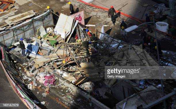 Rescuers work at an explosion site in front of a shopping mall on March 4, 2013 in Shenyang, China. More than 20 workers were injured after an...