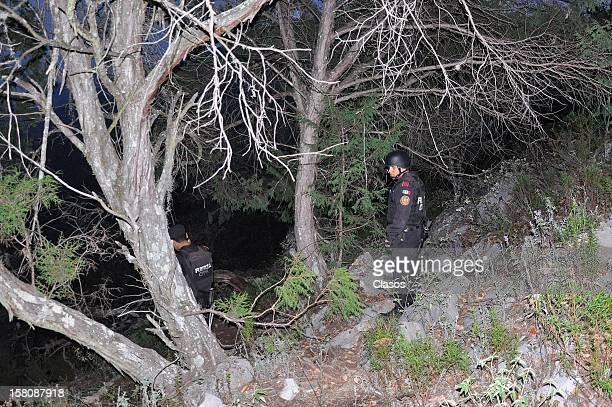 Rescuers work at the area where the plane where the mexican singer Jenni Rivera was flying crashed close to the Tejocote Ranch on December 09 2012 in...