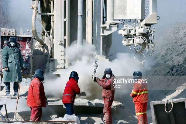 Rescuers work at the explosion site of a gold mine on January 19, 2021 in Qixia, Shandong Province of China. A total of 22 miners were trapped more...