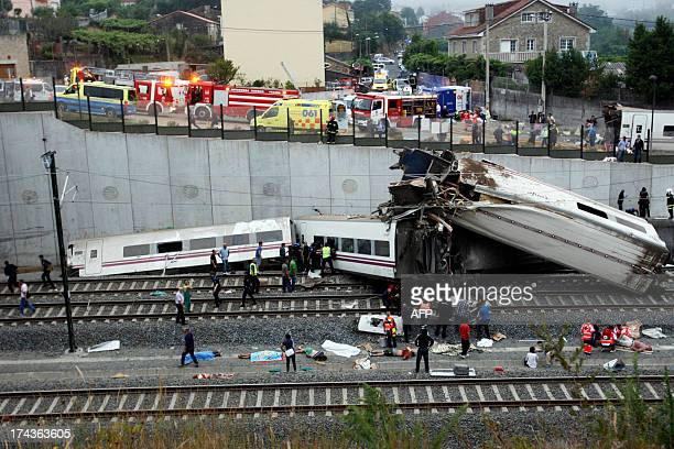 Rescuers work at the site of a train accident near the city of Santiago de Compostela on July 24 2013 At least 35 people died and 200 people were...