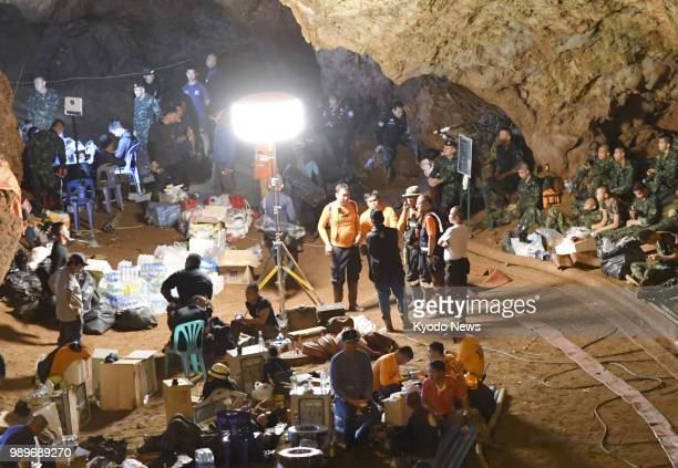 Rescuers work at the Tham Luang Nang Non cave complex in northern Thailand on June 27 where 12 boys and their soccer coach are believed to be trapped...