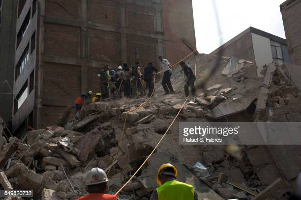 Rescuers work in the rubble after a magnitude 71 earthquake struck on September 19 2017 in Mexico City Mexico The earthquake caused multiple...