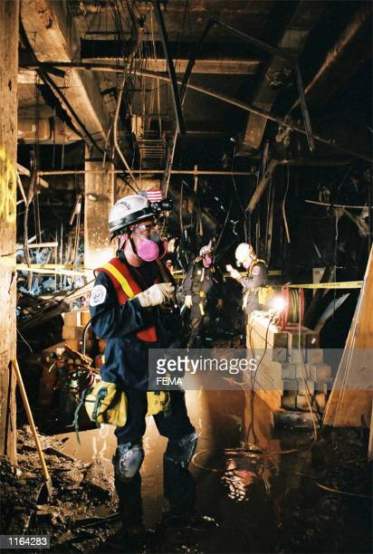 Rescuers work inside the Pentagon September 13, 2001 after an aircraft crashed into it September 11 as part of a terrorist attack.
