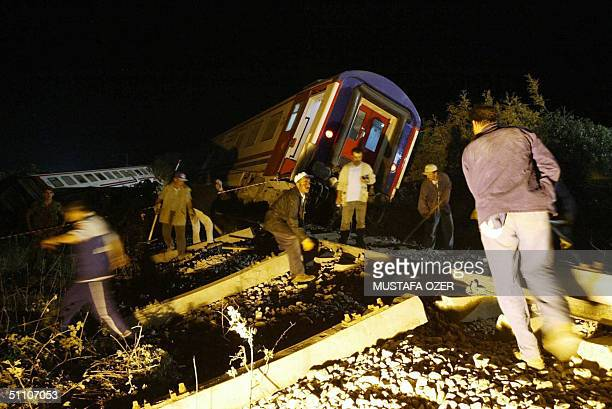 Rescuers work inside the train that went off its rails near the village of Pamukova about 150 km west of istanbul which caused according to official...