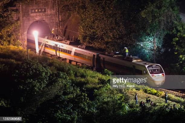 Rescuers work near the site where a train derailed inside a tunnel in the mountains of Hualien, eastern Taiwan on April 2, 2021 in Hualien, Taiwan....