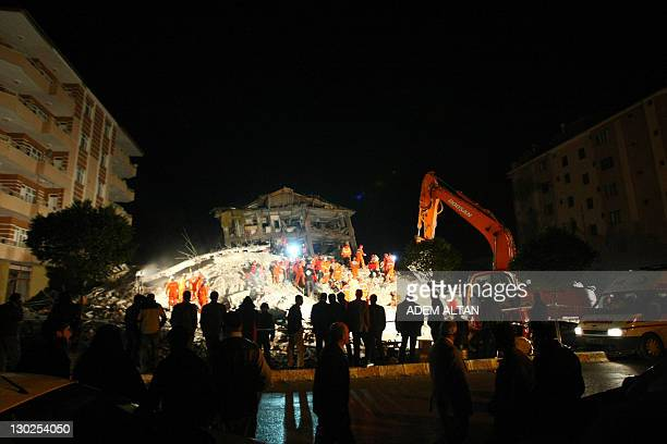 Rescuers work on the rubble of houses in Ercis in the eastern Turkish province of Van on October 25 2011 As the death toll reached 459 and the Red...