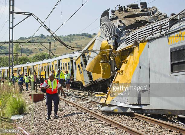 Rescuers work on the site of a train accident near Kalefong station Attridgeville in the west of Pretoria on January 31 2013 The collision between...