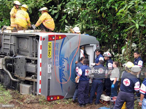 Rescuers work on the wreckage of a coach which crashed 28 December 2005 in the mountainous area near San Ramon Alajuela 80 km west of San Jose with...