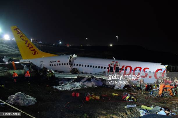TOPSHOT Rescuers work to extract passengers from the crash of a Pegasus Airlines Boeing 737 airplane after it skidded off the runway upon landing at...