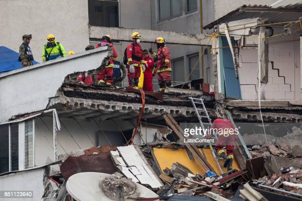 Rescuers work to find bodies of the victims two days after the magnitude 71 earthquake jolted central Mexico killing more than 250 hundred people...