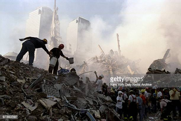 Rescuers work to free a victim from under the rubble at the site of the World Trade Center, demolished in a terrorist attack.