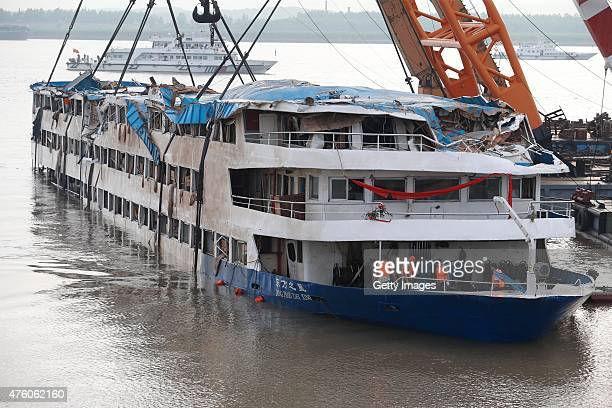 Rescuers work to raise the capsized ship Dongfangzhixing in the Yangtze River on June 5 2015 in Jingzhou China Fourteen people have been rescued and...