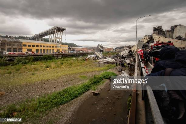 Rescuers work to search for survivors after a section of the Morandi motorway bridge collapsed earlier on August 14 2018 in Genoa Italy At least 30...