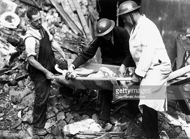 Rescuing a dog after an air raid Second World War October 1940 'Using a small stretcher to remove a dog from a bombed building Succour for animals in...